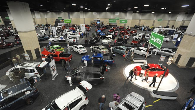 Several vehicles on the floor during the 2016 Knoxville Auto Show at the Knoxville Convention Center in Knoxville on Saturday, Feb. 27, 2016. (NEWS SENTINEL)