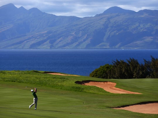 Adam Scott hits a shot on the 13th hole during the