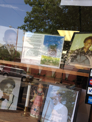 "A memorial to Sylvester ""Button"" Combs Jr. in the window"
