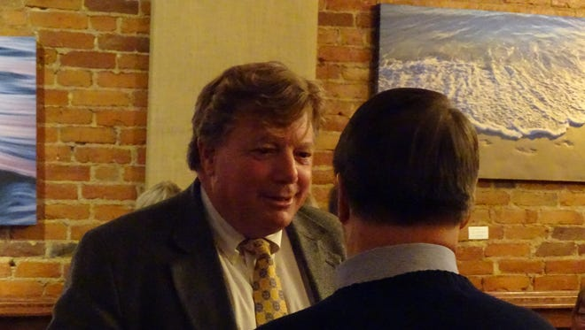 Judge Bruce Winters celebrates with a supporter Tuesday night at the Clinton House after he learned he was re-elected to Ottawa County Common Pleas Court.
