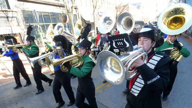 Band members from Richmond, Hagerstown, Centerville and Northeastern play Saturday, Nov. 5, 2016 during the Veterans Parade through downtown Richmond.