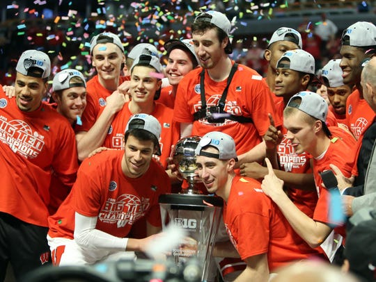 Wisconsin celebrates winning the Big 10 tournament,