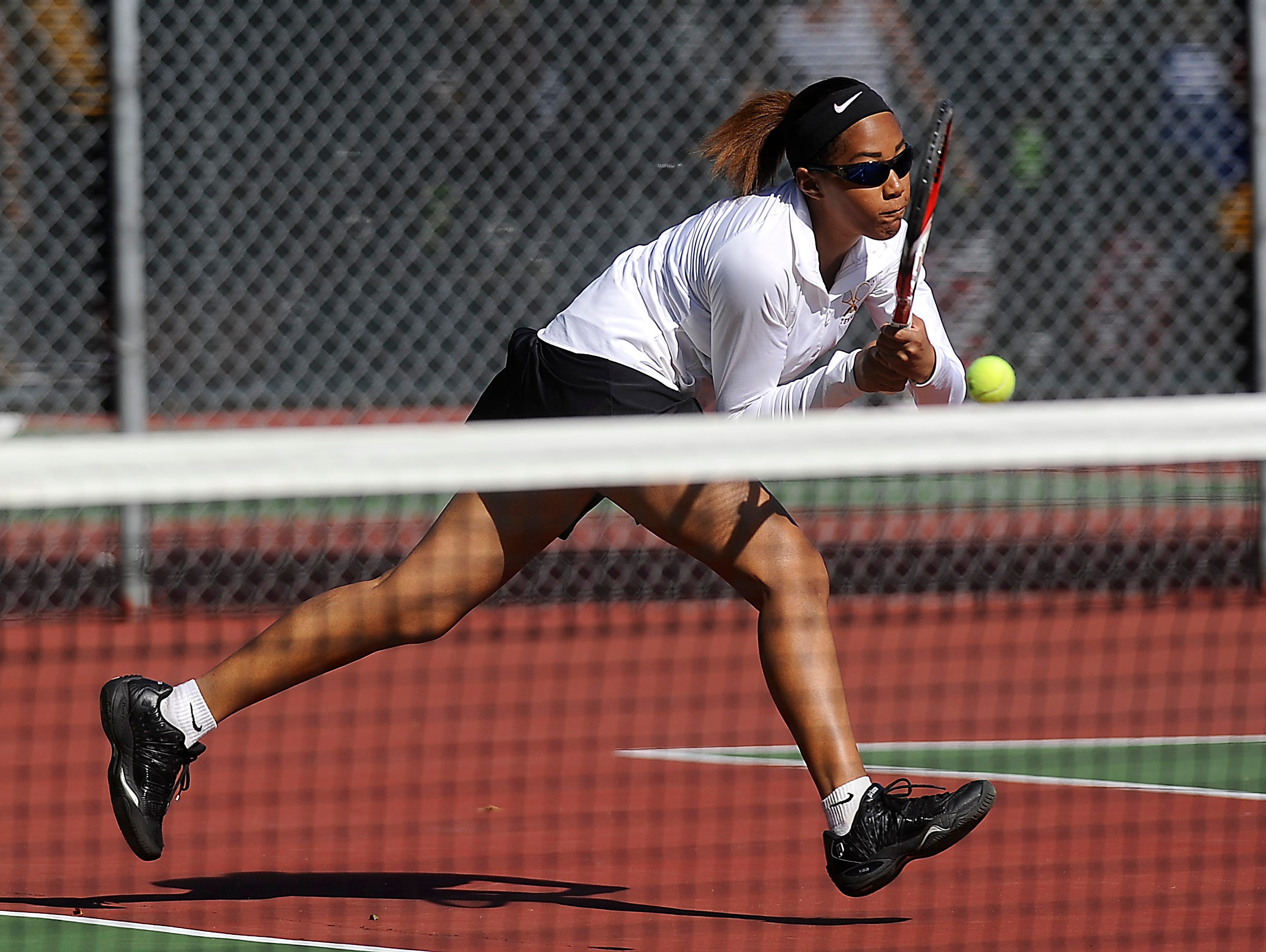 Roosevelt's Lexy Ronning returns the ball to Rapid City Stevens' Tianna Duba and Alisha Wiedmeier during doubles third round championship of the SD high school girls state tournament at McKennan Park in Sioux Falls, SD; Friday, Oct. 9, 2015.