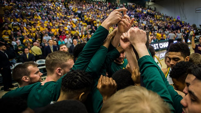 UVM huddles before the start of the America East Championship against Albany at Patrick Gym in Burlington, Vt., on Saturday, March 11, 2017. UVM won, clinching their place in the NCAA tournament, 56-53.