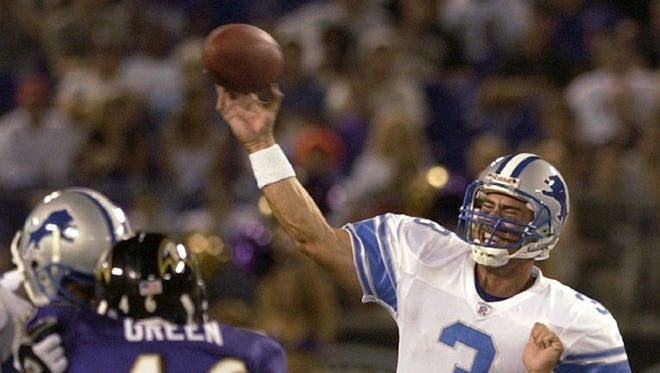 -  -Detroit Lions quarterback Joey Harrington (3) passes as Baltimore Ravens linebacker Louis Green (46) closes in during the third quarter Friday, Aug. 9, 2002, at Ravens Stadium in Baltimore. (AP Photo/Nick Wass)