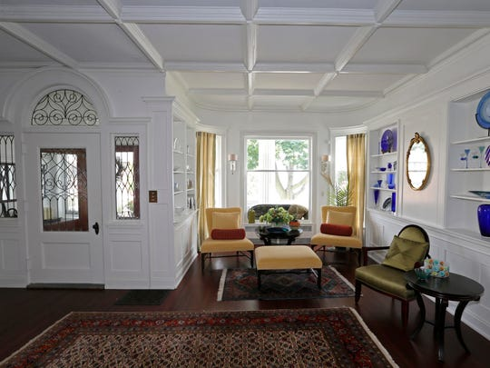 The entryway to the Racine home of Robert and Mette Baran features a remodeled ceiling and open area.