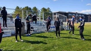 The Finger Lakes CC cross country team prepares for last weekend's meet at Fulton-Montgomery CC.