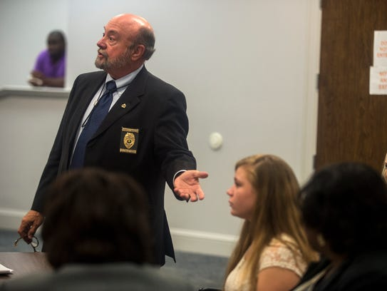 District Attorney Randall Houston gestures to 15-year-old