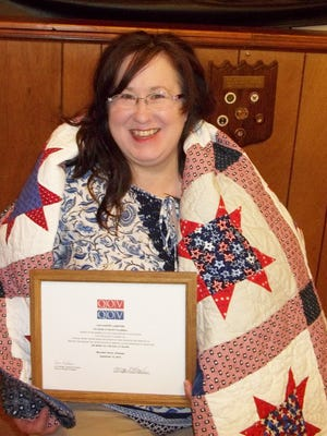 Lisa Gunter Lunsford, a US Navy veteran, served as an aircraft electrician during the Iraq war.  She was recently awarded a Quilt of Valor by Mountain Home Quilts of Valor at the local American Legion Post 52 where she serves as Adjutant.