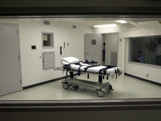 This file photo shows Alabama's  lethal injection chamber at Holman Correctional Facility in Atmore, Ala.   Disease and suicide are claiming inmates on Alabama's death row faster than the executioner. With Alabama's capital punishment mechanism on hold for more than two years because of legal challenges and a shortage of drugs for lethal injections, five of the state's death row inmates have died without ever seeing the inside of the execution chamber.