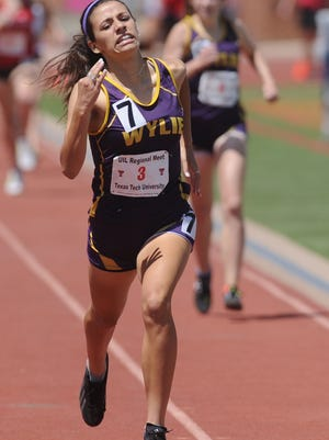 Wylie's Leandra Benton races to the finish line in the girls 800 meters. She finished second in 2:20.17 to earn a state berth at the Region I-4A track and field meet Saturday, April 28, 2018 at Lowrey Field in Lubbock.