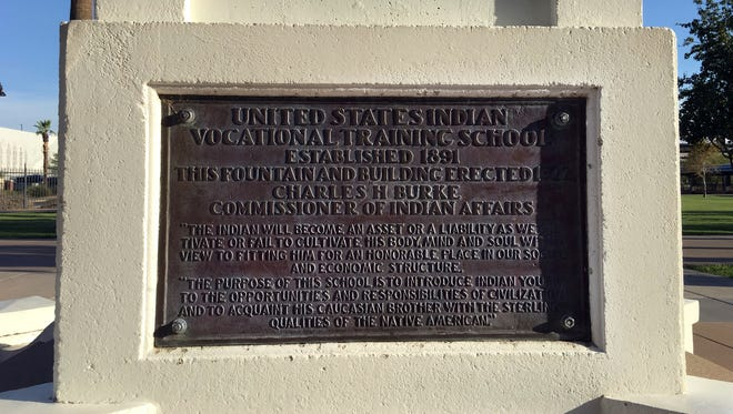 This Thursday, July 20, 2017 photo, shows a plaque at the Steele Indian School Park in Phoenix, where the former Phoenix Indian School for Native American Children used to sit.