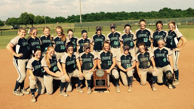 The Siegel softball team poses with its Class AAA state tournament runner-up trophy Friday.