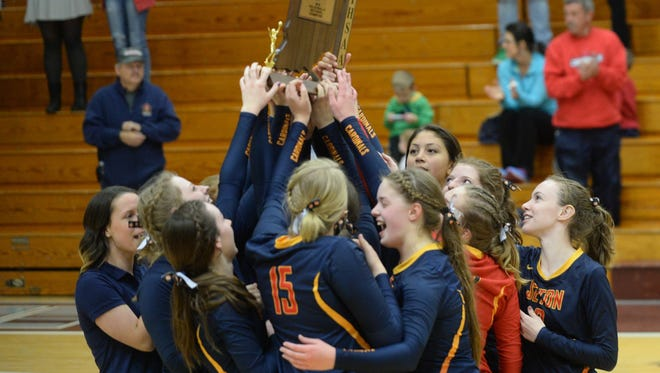 The Seton Catholic volleyball team celebrates a third straight sectional championship after defeating Union City Saturday, Oct. 22, 2016.