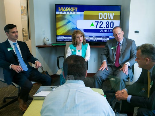 WSFS Bank Chief Financial Officer Dominic C. Canuso (from left), Chief Human Capital Officer Peggy H. Eddens, Chief Corporate Development Office Rodger Levenson and President and CEO Mark A. Turner meet in a conference room at the WSFS Bank branch on North Union Street in Wilmington.