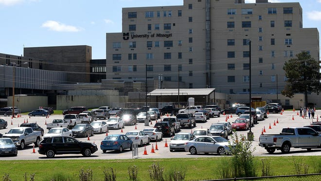 About 50 vehicles wait in line for a COVID-19 test on Monday at the Mizzou North campus parking lot, 115 Business Loop 70 West.