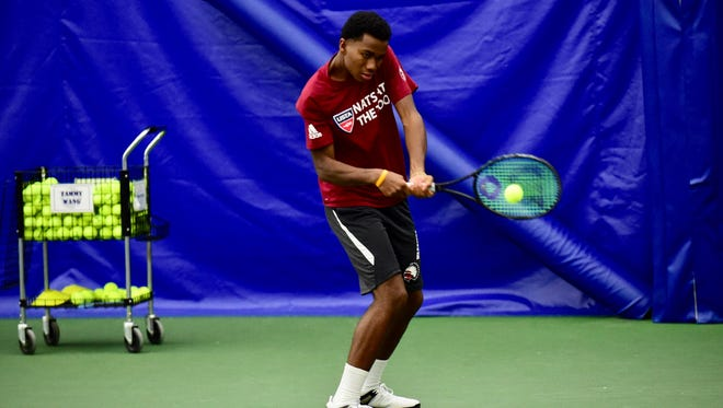 Birmingham Brother Rice junior Jarreau Campbell works on a backhand shot during Wednesday's practice at Bloomfield Tennis.& Fitness.
