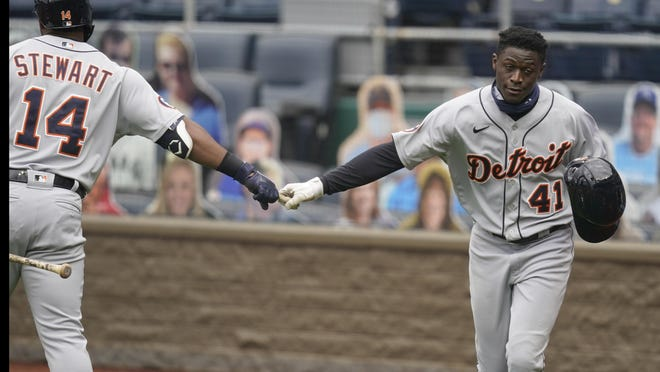 Detroit Tigers Daz Cameron (41) is congratulated by teammate Christin Stewart (14) after scoring on a double by Brandon Dixon during the first inning of a baseball game at Kauffman Stadium in Kansas City, Mo., Sunday, Sept. 27, 2020.