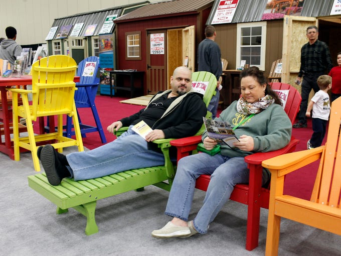 Mike and Patricia Damron, of Lawrenceburg, Ky., try out the deck chairs on display at the 13th annual Build, Renovate and Landscape Expo. Exhibitors provided booths and displays of cabinetry, countertops, flooring, sunrooms and additions, basement finishing and landscaping items. Feb. 9, 2014