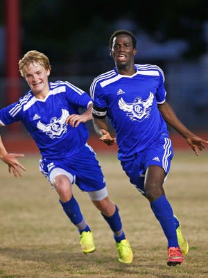 Sandra Day O'Connor High's Musa Morris (right) reacts after scoring the game-winning goal against Tolleson High during the boys state soccer tournament played at Phoenix Alhambra High School on Wednesday, Feb. 4, 2015. Sandra Day O'Connor High beat Tolleson High 1-0.