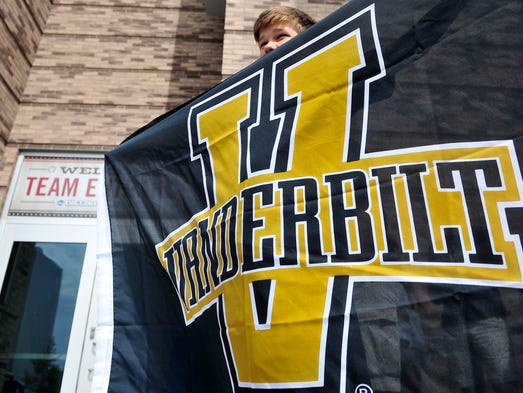 Vanderbilt fan Zachary Snider, 12, of Murfreesboro waits for players to arrive at TD Ameritrade Park on Monday.