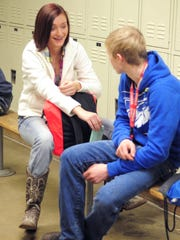 Butler Tech junior Emily Stogsdill talks to her boyfriend, Max Armbruster, also a junior, at the end of a welding class Wednesday. Instructor Shane McKinney says recently he's seen the parents of his students being very supportive of their children's pursuit of welding and the trades.