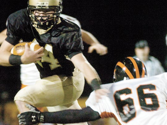 Delone Catholic's Noah Landi runs past Hanover's Logan