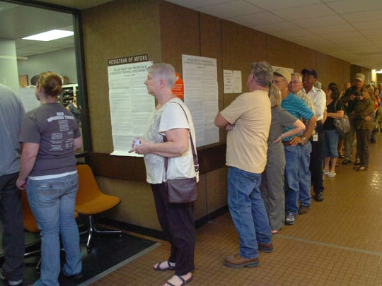 Voters wait on the first floor of the Rapides Parish Courthouse to enter the Registrar of Voters' Office for early voting during the 2012 elections.