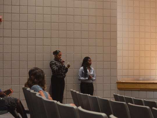 Volunteers read out questions from the crowd to the panel members at a panel discussion Saturday afternoon about street and gang violence in Murfreesboro and Rutherford County as a whole.