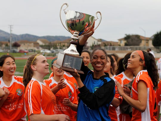 Wind Girls hoist the trophy after winning the Salinas Californian All-Star Girls Soccer Classic at Alisal High School on Sunday, March 18.