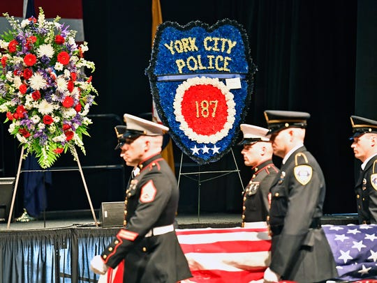 Members of the U.S. Marine Corps and York City Police