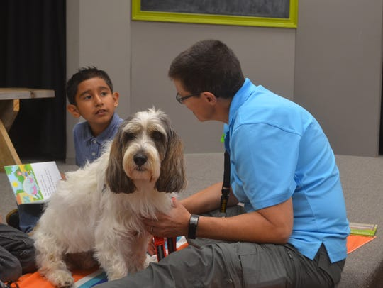 Eight-year-old Angel Suarez Torres reads to Pet Partners'