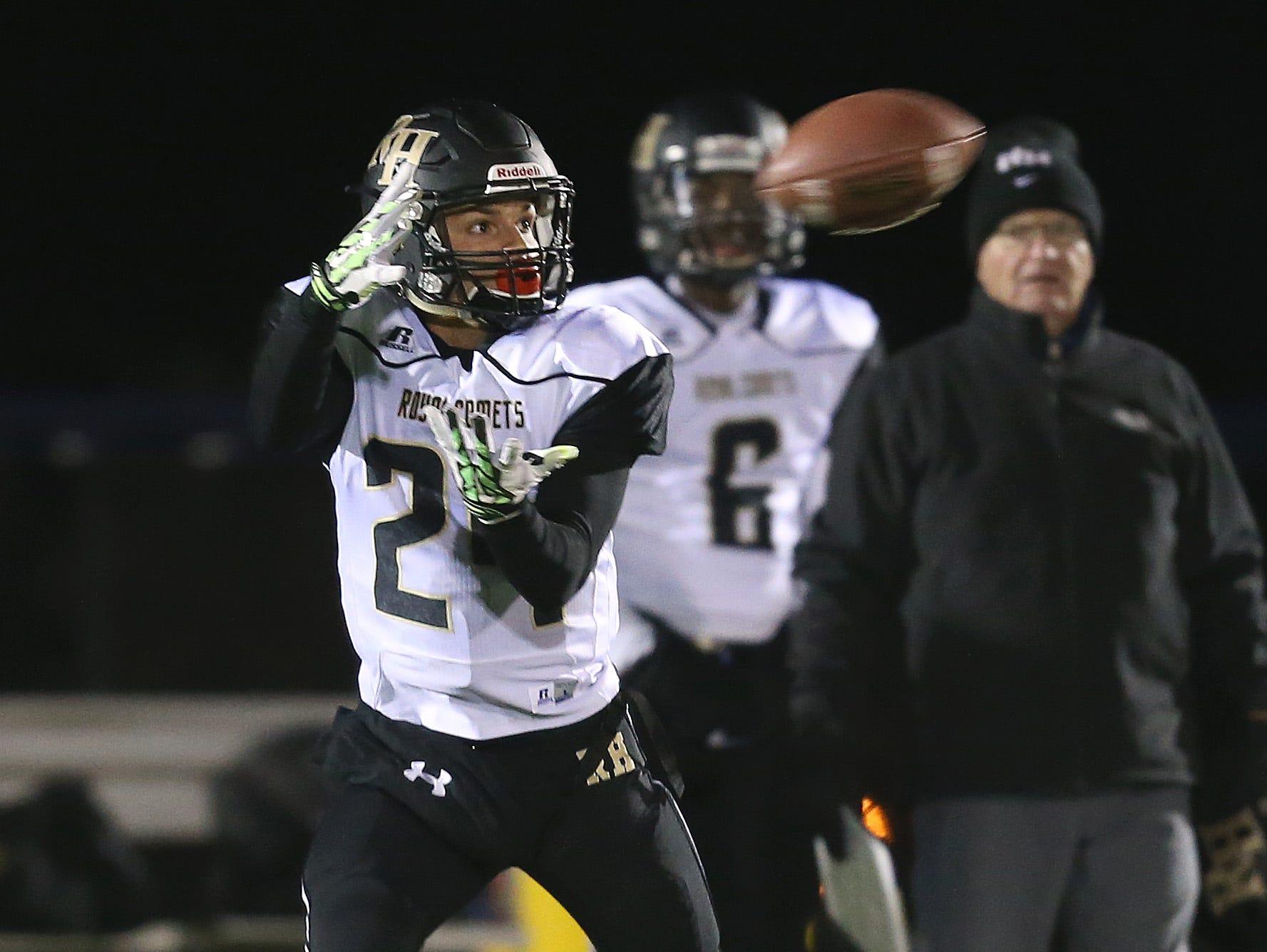 Rush-Henrietta's Joseph Ortiz hauls in a catch and runs for a 74-yard touchdown against Pittsford.