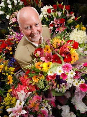 File photo shows 1-800-Flowers.com CEO Jim McCann in a New York retail store.