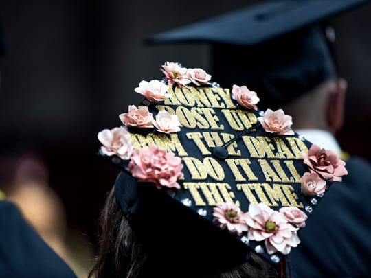 A graduate wears a cap decorated with Taylor Swift lyrics during Stevens Point Area Senior High's graduation ceremony in Stevens Point, Wis., May 27, 2018.