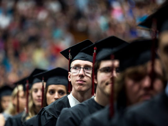Graduates listen to student speakers during Stevens