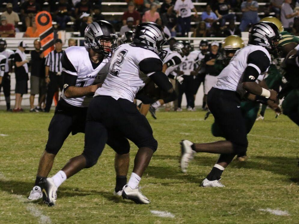Jay Thorpe takes a handoff from Cade Willingham during South Side's game at Jackson Central-Merry last week.