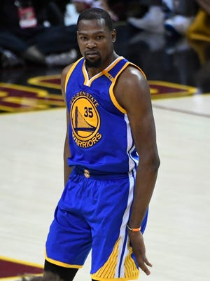 Kevin Durant celebrates after making a three-point basket during the fourth quarter in Game 3 of the 2017 NBA Finals.