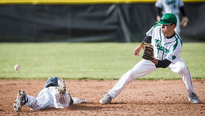 Yorktown's Luke Hill, shown here earlier this season against Delta, had a two-run triple and made a spectacular defensive play Friday against Hamilton Heights.