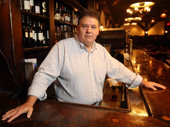 Peter Tumulty of Milltown, co-owner of Tumulty's Pub, ready behind the bar.