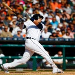 Sep 25, 2016; Detroit, MI, USA; Detroit Tigers designated hitter Victor Martinez hits a grand slam home run in the third inning against the Kansas City Royals at Comerica Park.