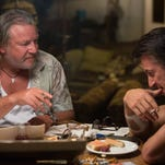 "Ray Winstone, left, and Sean Penn in ""The Gunman."""