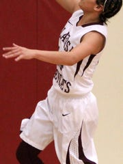 Cassie Vickery attempts a layup Saturday afternoon. Tularosa defeated Socorro 71-13 in their season opener.