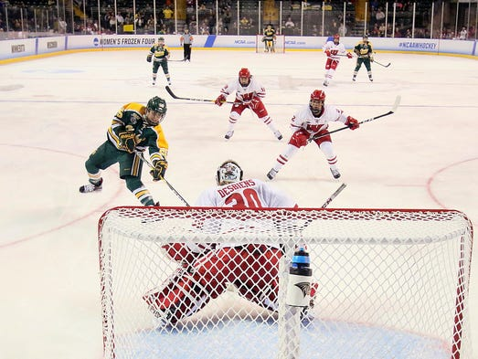 Clarkson forward Rhyen McGill tries to get a shot past