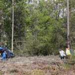 First responders carry a victim to a LifeFlight helicopter. The patient was brought by ambulance to where the helicopter sat in a clearing in DeSoto National Forest. A helicopter working on a controlled burn crashed this afternoon.
