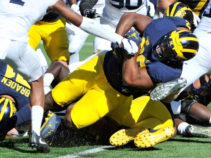 Michigan's Khalid Hill scores the first touchdown of