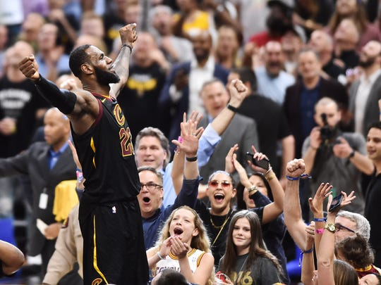 May 5, 2018; Cleveland, OH, USA; Cleveland Cavaliers forward LeBron James (23) stands on the scorer's table after hitting the final shot to win the game against the Toronto Raptors in game three of the second round of the 2018 NBA Playoffs at Quicken Loans Arena. Mandatory Credit: Ken Blaze-USA TODAY Sports