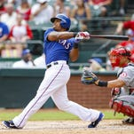 Aug 17, 2014; Arlington, TX, USA; Texas Rangers designated hitter Adrian Beltre (29) hits during the game against the Los Angeles Angels at Globe Life Park in Arlington. Mandatory Credit: Kevin Jairaj-USA TODAY Sports