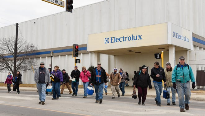 Employees walk to the parking lot after a shift change Tuesday, Jan. 30, at Electrolux in St. Cloud. Electrolux corporate officials announced the St. Cloud facility, which manufactures Frigidaire upright freezers, will continue production through 2019 and then close.