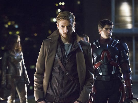 Rip Hunter (Arthur Darvill, center) rounds up a posse including Hawkgirl (Ciara Renee) and the Atom (Brandon Routh) to travel through time and stop a supervillain.